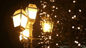 Street lamps in the snow at night