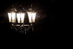 Street lamps in snowfall close up photo. Night. Royalty Free Stock Photography
