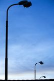Street lamps at sunrise Stock Photo