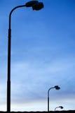 Street lamps at sunrise stock photo