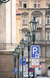 Street lamps and traffic signs in Prague. Royalty Free Stock Image