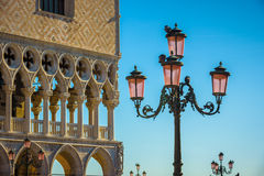 Street lamps in Venice with many pigeons sitting on them with bl Royalty Free Stock Photos