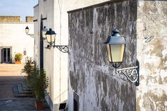 Street lamps on wall on narrow streets in the fortress Sant`Elmo in Napoli royalty free stock photography