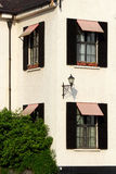Street lamps, Windows and shadow Stock Images