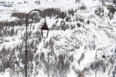Street lamps on a winter cold landscape Stock Image