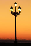 Street lantern. Street lamo against the orange sunset sky Royalty Free Stock Photography