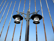 Street lantern. Over rusted pipes on Damietta coast ,Street light lamppost with  blue sky in background Stock Image