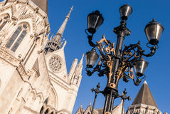 Street lantern. A street lantern with High Court building and blue sky on the background in London Stock Images