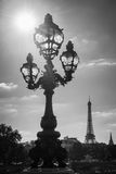 Street lantern on the Alexandre III Bridge against the Eiffel Tower in Paris Royalty Free Stock Photography
