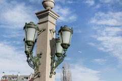 Street lantern  on blue cloudy sky background Stock Photography