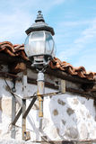 Street Lantern. Close up of a street lantern hanging on the wall under the roof Stock Photo