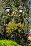 Street lantern decorated with geranium flowers in flowerpot. Street lantern decorated with geranium flowers in a flowerpot stock photos