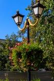 Street lantern decorated with geranium flowers in flowerpot. Street lantern decorated with geranium flowers in a flowerpot royalty free stock images