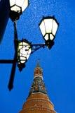 Street lantern and Kremlin tower in winter snowing evening Stock Photos