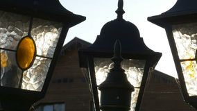A street lantern is in the rays of a sun stock footage