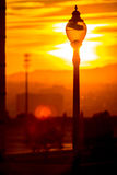 Street lantern and sunset sky Stock Photos