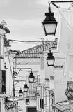 Street with lanterns in Evora. Detail of an old neighbourhood in Evora, Portugal UNESCO heritage with many lanterns Royalty Free Stock Photos