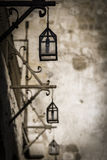Street lanterns. Hanging street lanterns in a black and white filter Stock Images