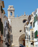 Street with a large church in Mahon, Menorca Stock Photo