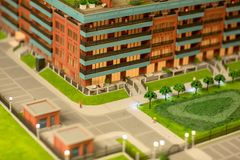Street layout. Street in new block of flats and park on layout of modern city Royalty Free Stock Image