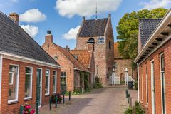 Street leading to the church tower of Ezinge Stock Photography