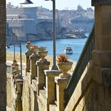 Street leading to the sea. Street along the wall of fortress leading to the sea on the island of Malta in historical part of Valletta Stock Photography