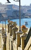 Street leading to the sea. Street along the wall of fortress leading to the sea on the island of Malta in historical part of Valletta Royalty Free Stock Photos