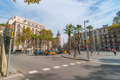 Street level view of pleasant day in Barcelona sunny afternoon, people at cafes, walking or relaxing in a park. Stock Photography