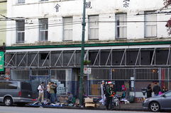 Street life along Hasting Street. In Vancouvers Downtown Eastside known for drug use, crime, homelessness, poverty, housing issues, unemployment, and loss of royalty free stock photo