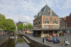 Street life in city Leeuwarden, Netherlands. Netherlands: On the square Waagplein stands the former weigh house. This historic building was a butter weighing Stock Photography