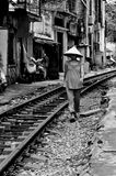 Street life in Hanoi. Street life picture of Vietnamese woman walking long the railroad Royalty Free Stock Photos