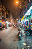 Street life of Hanoi at night in Vietnam, Asia. Royalty Free Stock Images