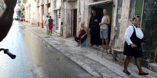 Street life in Havana after the rain. Royalty Free Stock Photo