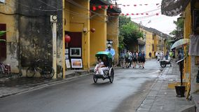 Street life in Hoi An, Vietnam. Cyclo carrying tourists on the street in Hoi An, Vietnam. Hoi An is the renown of World heritage cultural site stock video