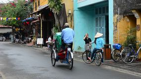 Street life in Hoi An, Vietnam. People and vehicles on the street in Hoi An, Vietnam. Hoi An is the renown of World heritage cultural site stock video footage