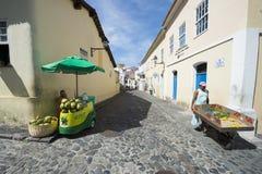 Street Life Pelourinho Salvador Brazil. SALVADOR, BRAZIL - MARCH 12, 2015: Vendor makes his way along a cobblestone street surrounded by colonial buildings in Royalty Free Stock Photos