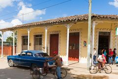 Street life view with cuban p. Eoples and american blue Chrysler classic car in Santa Clara Cuba - Serie Cuba Reportage Royalty Free Stock Photography