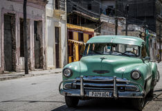 Street life view  in Havana Cuba with parked Oldtimer Stock Photo
