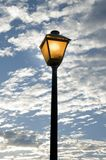Street light. A single street lamp with a fall sky background stock photos