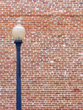Street light. Against brick wall Stock Photography