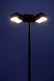 Street Light. Illuminated halogen street light at night with dark background Stock Photo