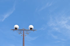 Street light against blue sky Royalty Free Stock Image