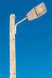 Street light against a blue sky background Stock Photo