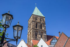 Street light and church tower in Rheine Royalty Free Stock Images