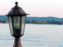 Street light closeup with river in background Stock Photography