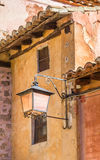 Street light on colorful houses in Albarracin Stock Images