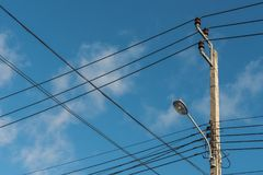 Street light, electric spotlight pole. With blue sky as background royalty free stock photography
