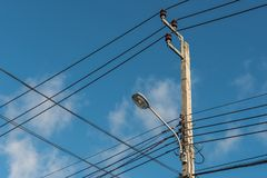 Street light, electric spotlight pole. With blue sky as background stock images