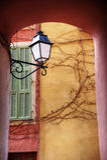 Street light. Hanging street light in an arch above a walk way Stock Photo