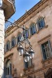 Street light hanging mounted on wall, Barcelona Stock Photos